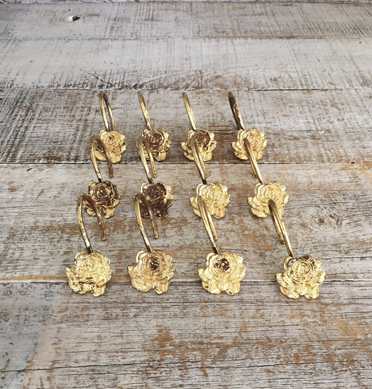 mid century flower brass drapery hooks