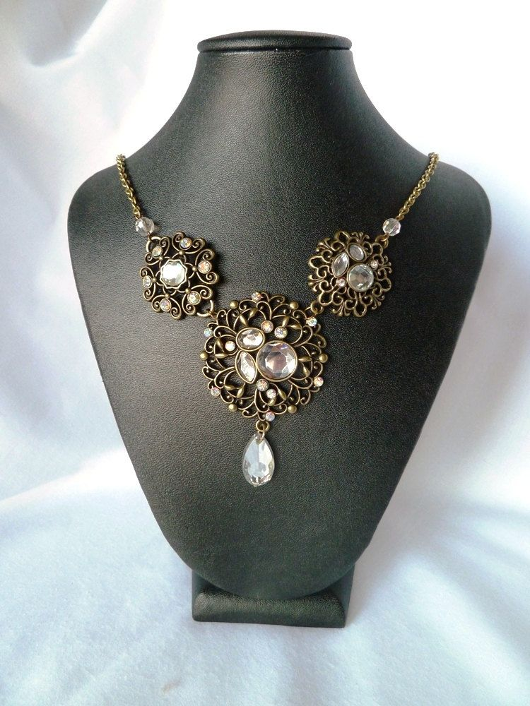 Antique gold statement necklace & earrings. $40.00, via Etsy.