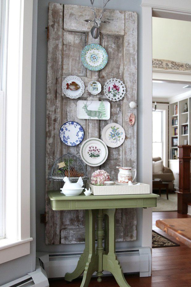 Old wood doors and antique plates makes beautiful rustic gallery wall decoration