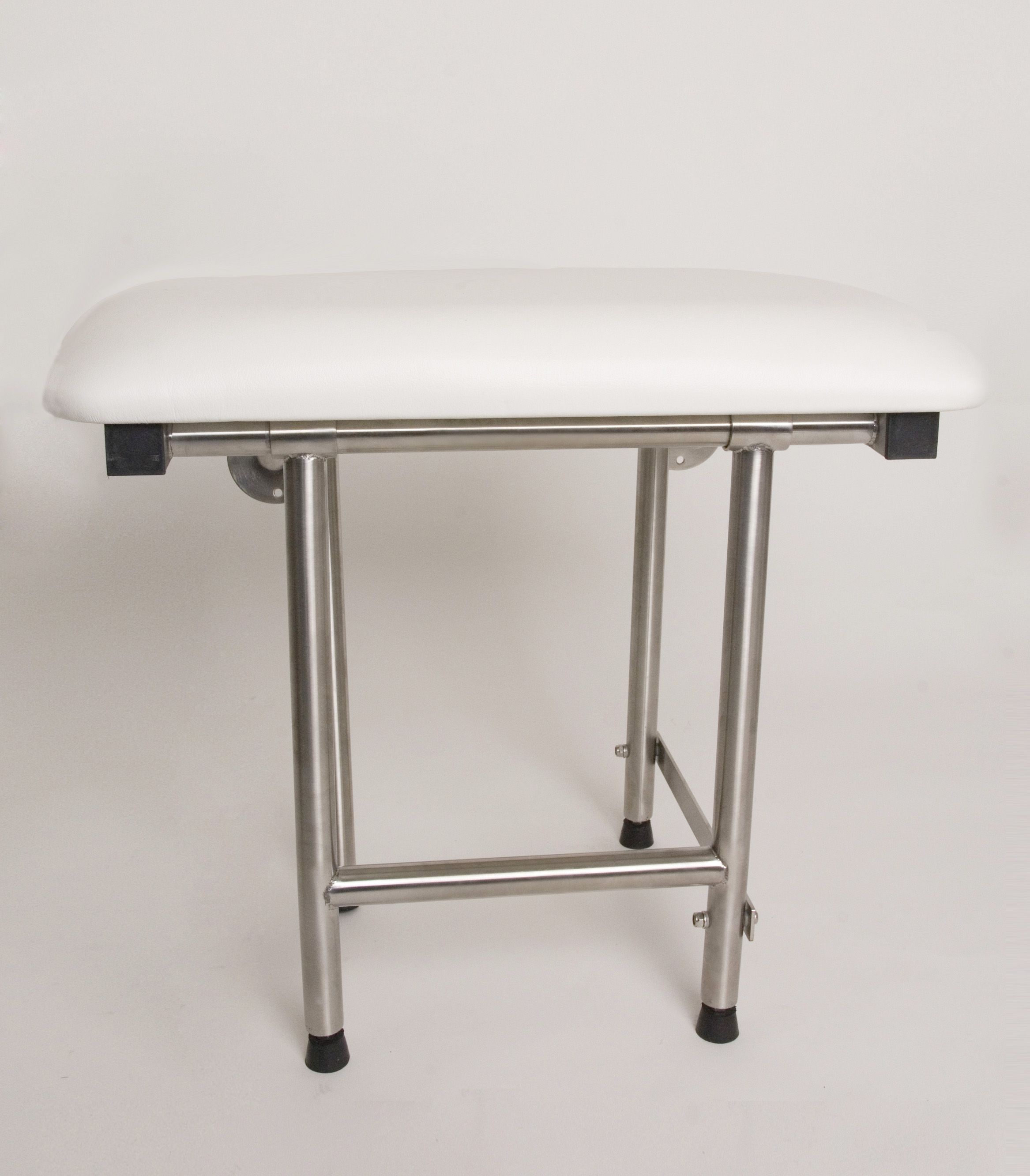 Padded, rectangular shower seat with four swing down legs. Folds ...