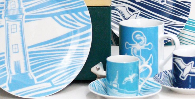 Collaborating with the wonderful Mini Moderns and inspired by 1950s linocuts, 'Whitby' captures the majesty and beauty of the sea.    Influenced by the vibrancy of a working harbour, the linocut style expresses perfectly the movement of the waves and the ruggedness of the coastline.