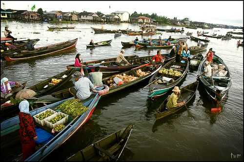 Floating Market, Banjarmasin. @ Floating Market, Muara Kuin.  Muara Kuin on the Barito River, Banjarmasin is one of two such floating market in South East Asia, the other one located in Thailand. Farmers and traders brought their goods to trade on boats every morning.  It has always been a farmers' market and it's interesting to see the genuine river-based way of life. Trading is done until 9am.