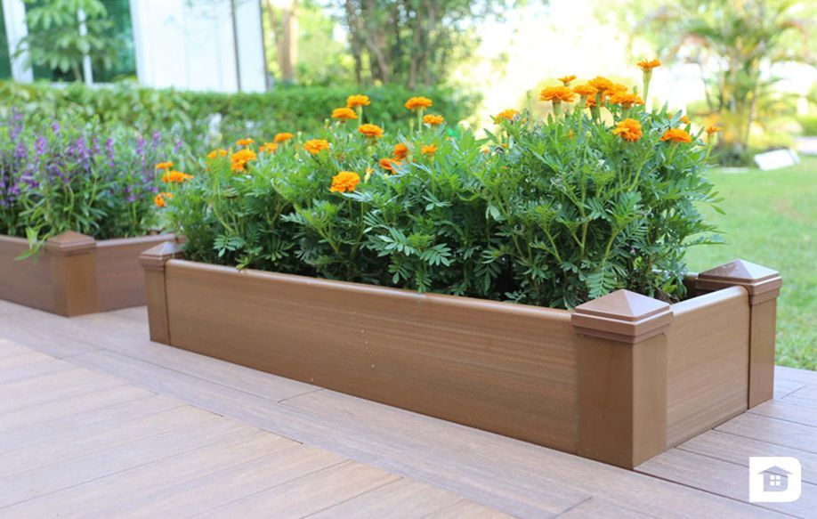 Wood planter box composite decking newtechwood for Garden decking planters