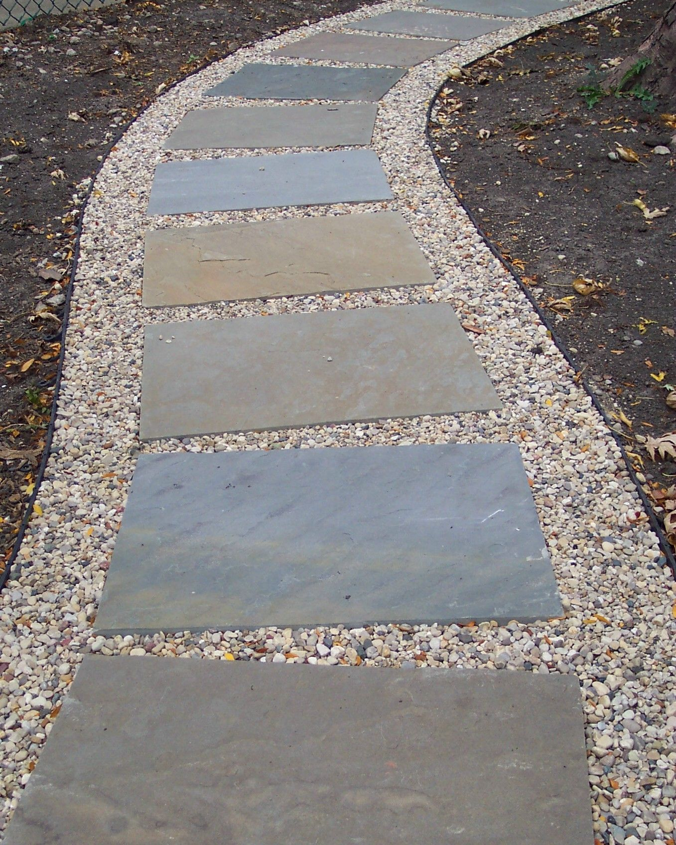 Stone and gravel path from driveway to front porch for Paving designs for small garden path