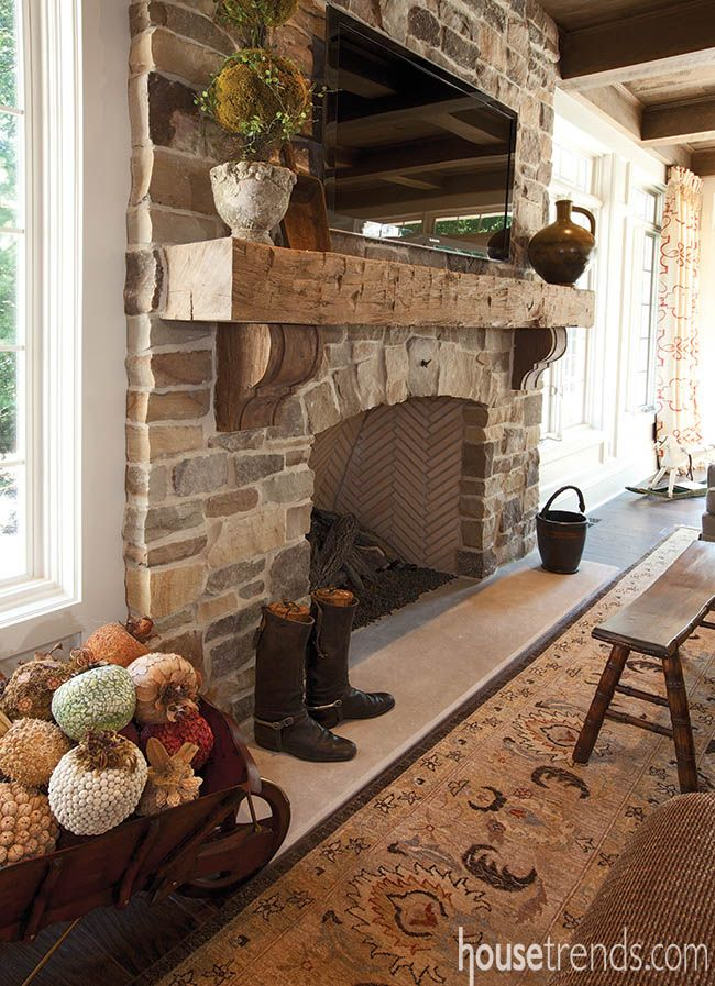 A stone fireplace with a rough hewn mantle light up this room with