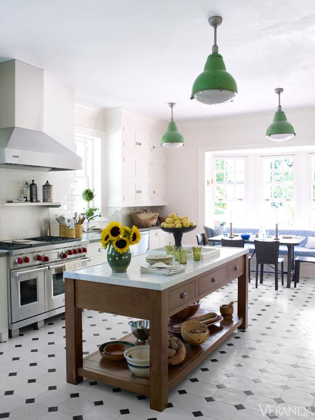 With black-and-white tiled floors and vintage pendants, this renovated kitchen seems pristinely original. Custom island and cabinetry. Range, Wolf. Hood, Viking. Image originally appeared in the January/February 2013 issue of Veranda. INTERIOR DESIGN BY BUNNY WILLIAMS   - Veranda.com