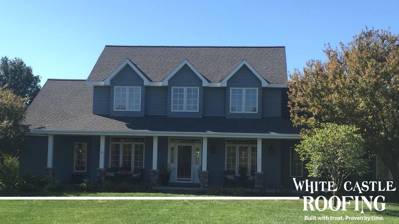 The Way The White Trim Pops Against The Gray Tones Of The Siding And The Certainteed Landmark Ir Colonia Roofing Contractors Grand Island Grand Island Nebraska