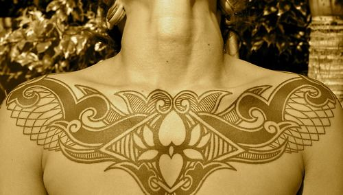 Tribal Chest Tattoo, Symmetrical And Well Designed. I