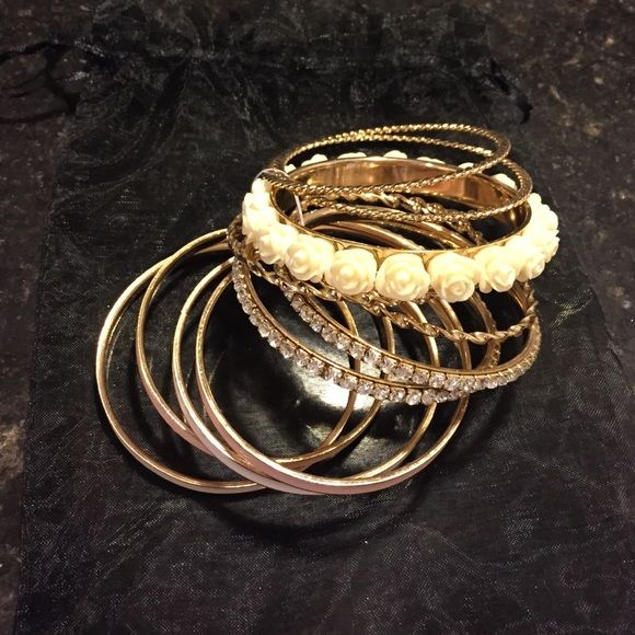 NWT bracelet set New . Set of 11 bracelets that can be worn together or separately. Great color scheme. Comes with black shear bag. Jewelry Bracelets