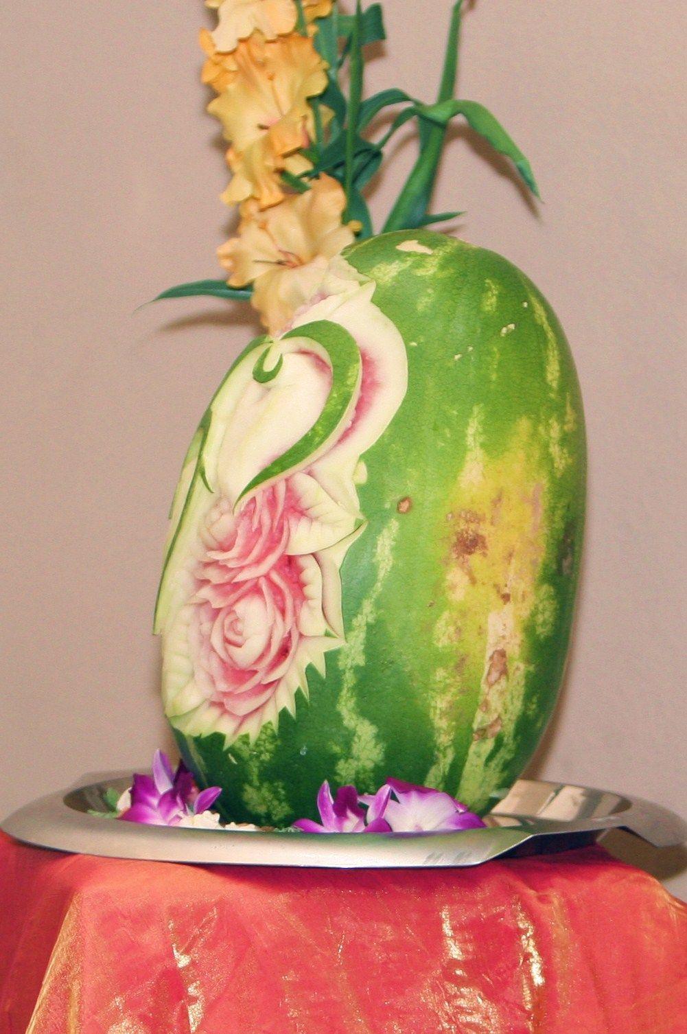 Wedding food table decor: carved fruit!