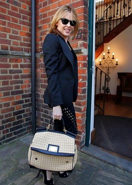Kylie Minogue spotted with a Miss Sicily Satchel woven from natural raffia material and black leather trims