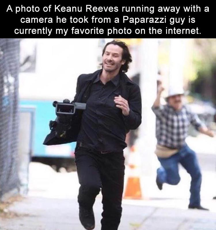 A Photo Of Keanu Reeves Running Away With A Camera He Took From A Paparazzi Guy Is Currently My Favorite Photo On The Internet