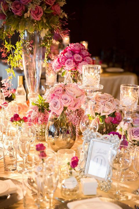 Beautiful table of roses in shades of pink crystal and framed menu your online wedding planning guide to help the planning process be simple and fun free wedding planning tools tips and inspiration junglespirit Choice Image