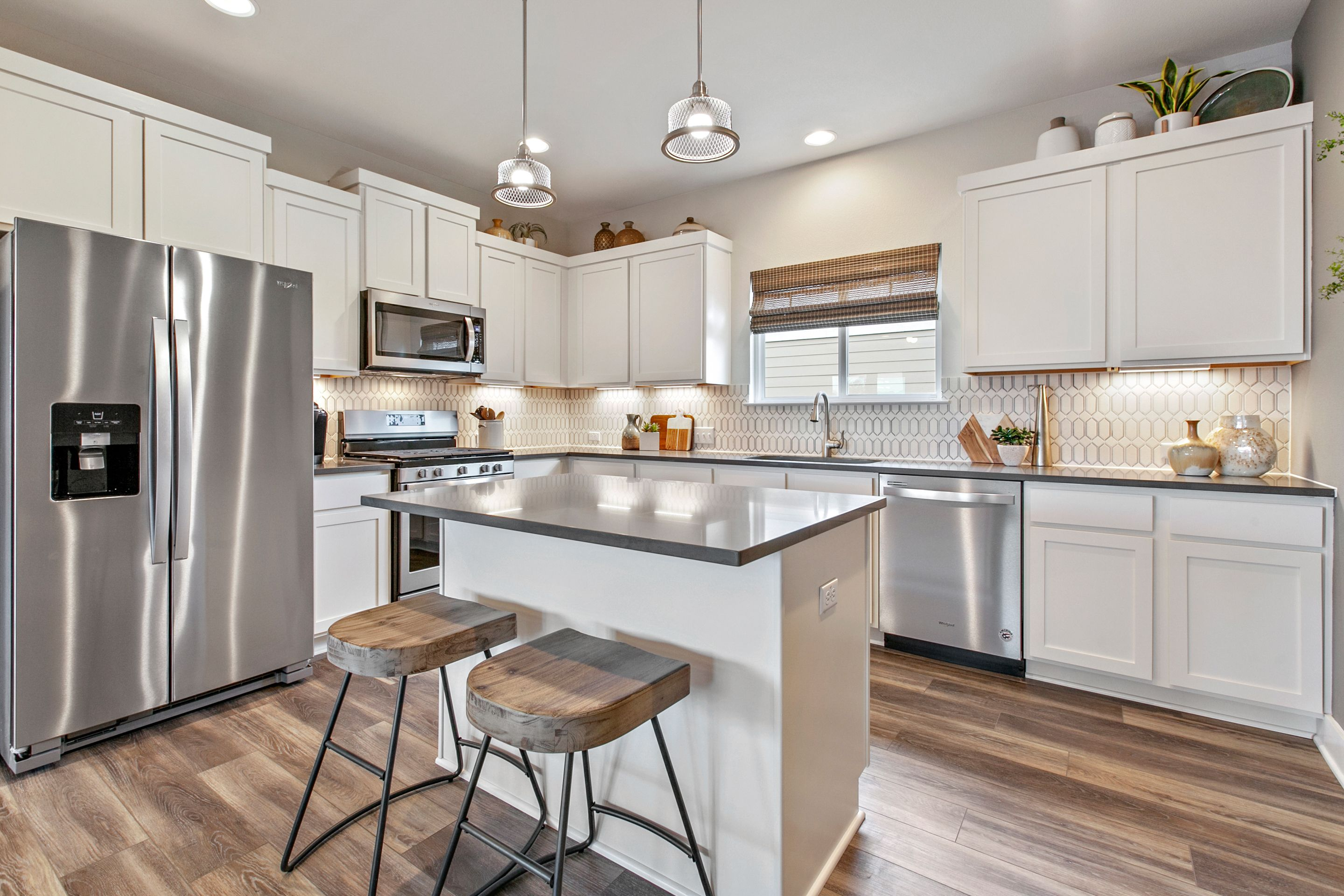 We love the neutral tones and textures of this kitchen at ...