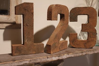 love the rusty numbers....they're paper mache!