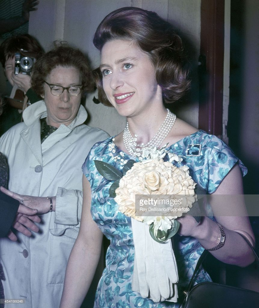 Princess Margaret (right) leaving a reception at the Victorian League Students' Club on Leicester Square in London on 7th May 1962.