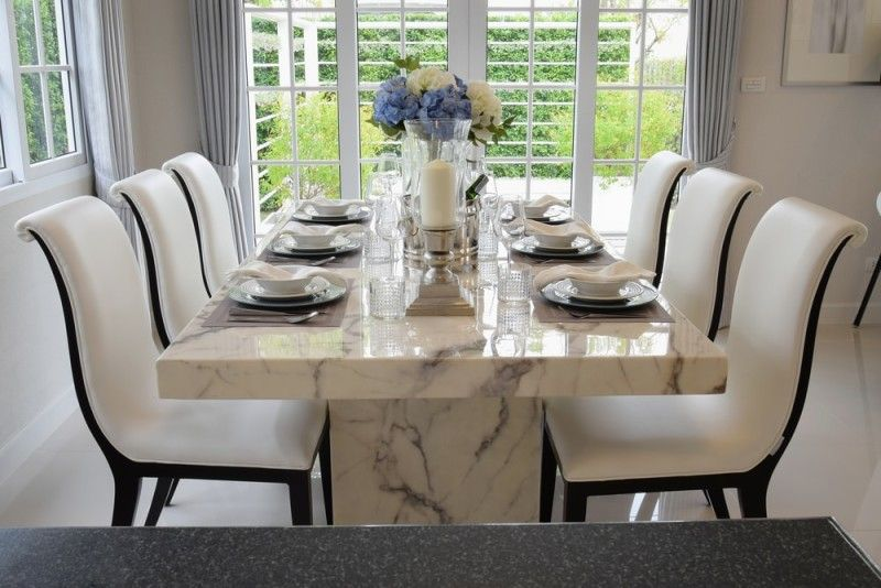 Marble dining table and modern comfortable chairs in a vintage style