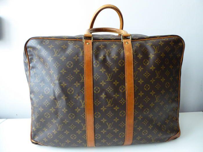 Plateforme de ventes aux enchères en ligne Catawiki   Louis Vuitton -  Sirius 55 Sac de 6648646adb2