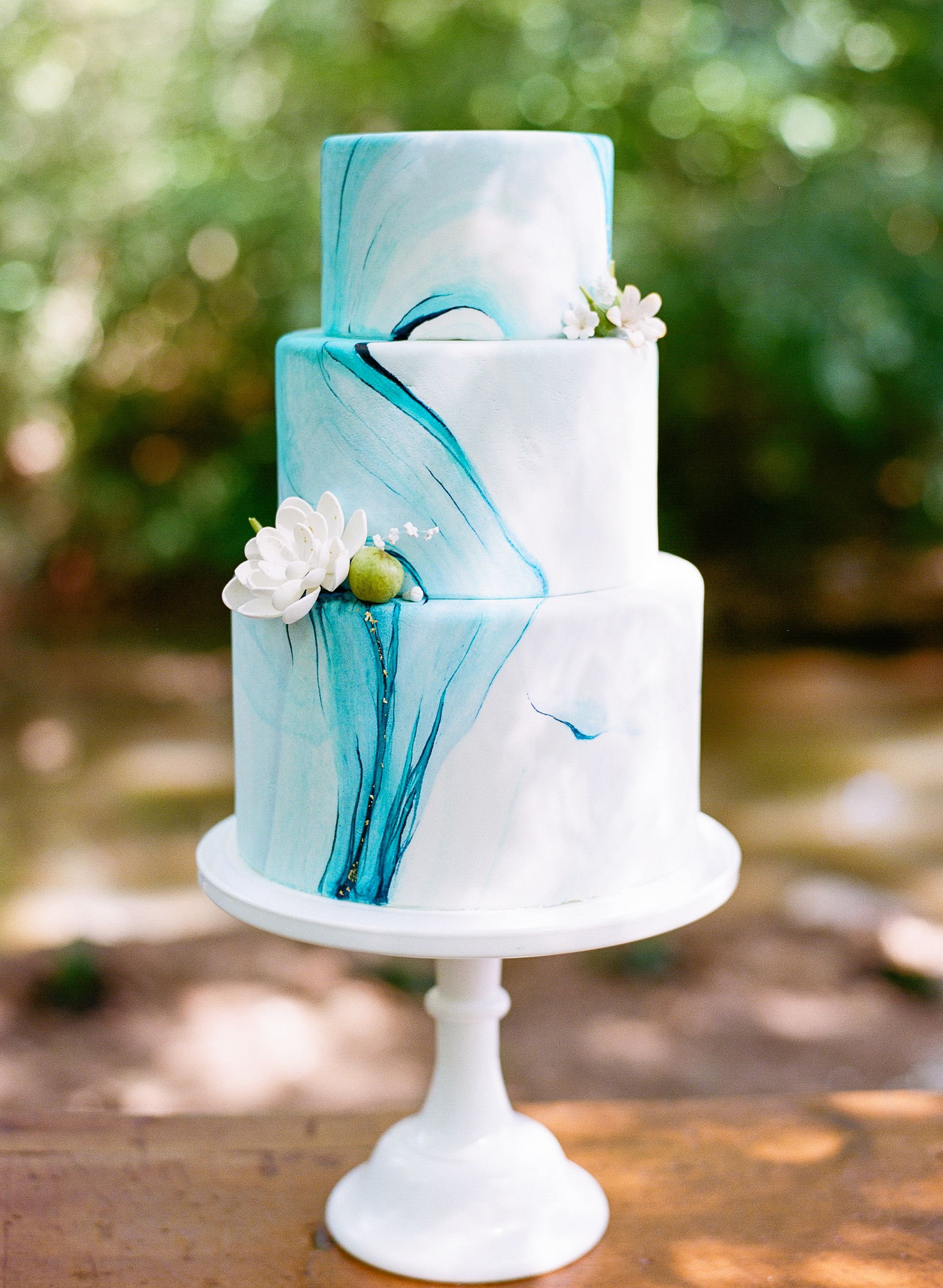 blue marble wedding cake with gold flakesthe celestial cakery