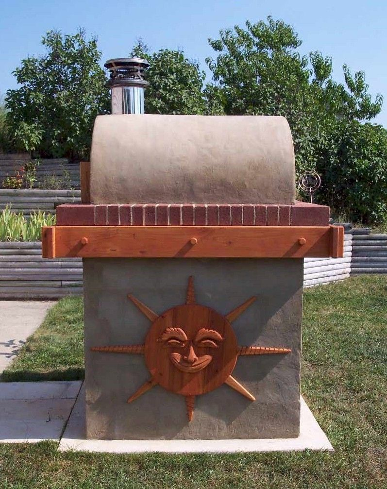 The Koval Family Wood Fired Brick Pizza Oven in Michigan.  This DIY Pizza Oven was built using the Cortile Barile foam oven forms.