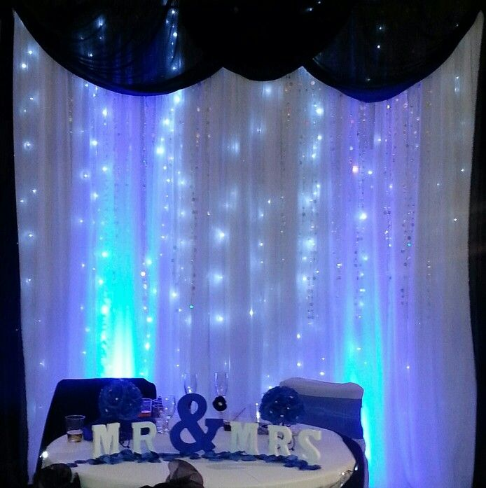Sweetheart Table With Sheer Backdrop, Royal Blue Drape And
