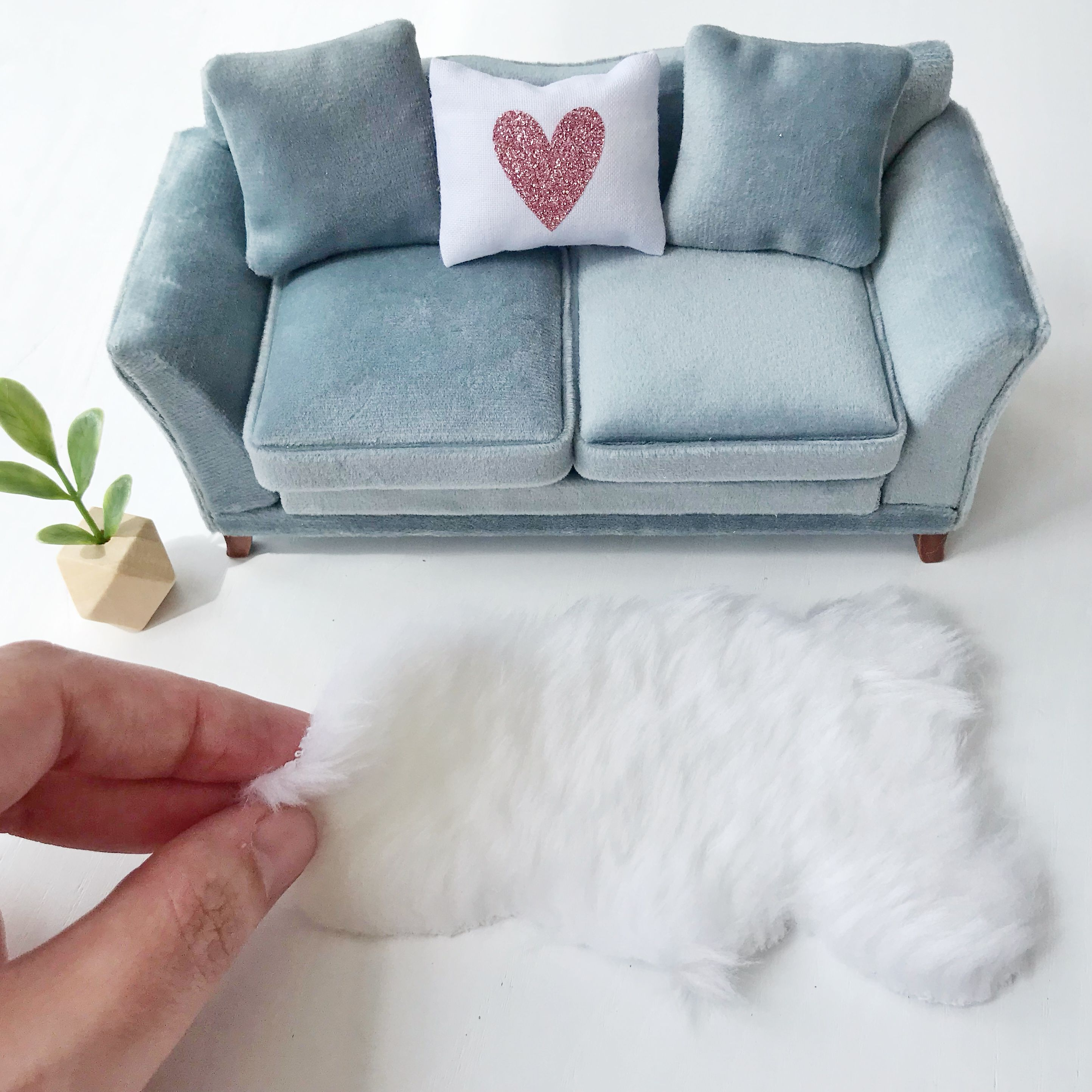 Stylish grey modern miniature dollhouse sofa with miniature rug