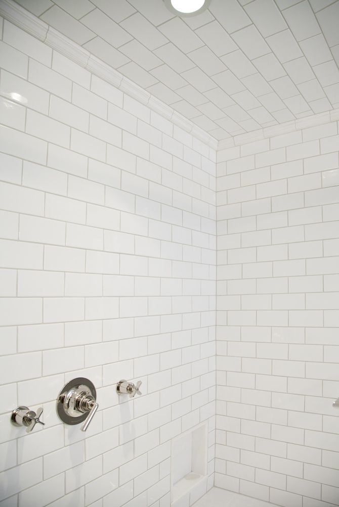 The Shower Ceiling Is Also Covered In White Subway Tile And The
