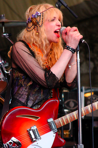 Courtney Love wearing a bespoke Mucha headdress I made for her in I think 09 or 10.  At SXSW