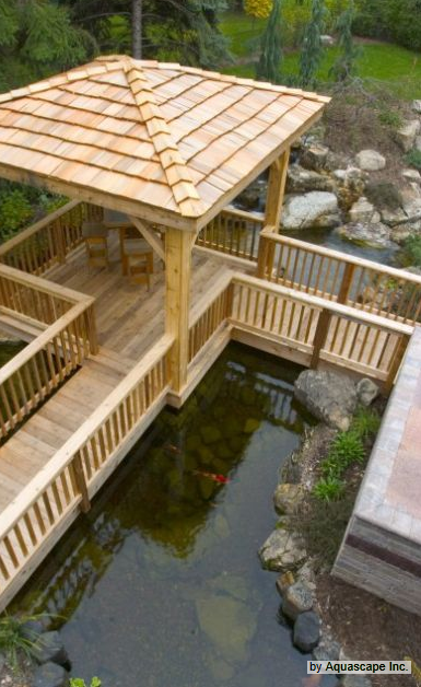 Redwood deck over koi pond covered deck and wooden for Koi pond deck