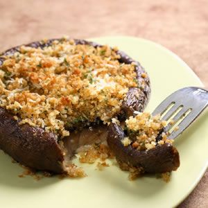 """Love stuffed mushrooms! So what could be better than a """"super-sized"""" Portobello? This basic recipe is a handy foundation for your own combinations of herbs and cheeses. I'd love to replace the parm with a Rosemary Asiago and add a bit of dried Italian herbs."""