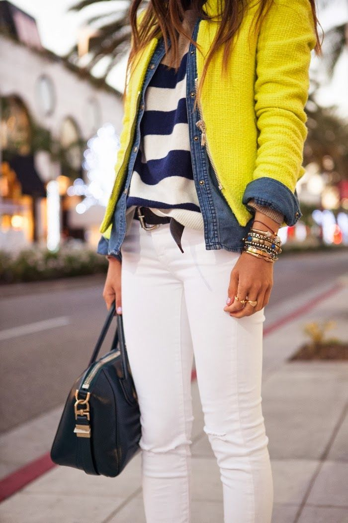 Yellow cardigan, denim jacket, blouse and white pants with handbag ...