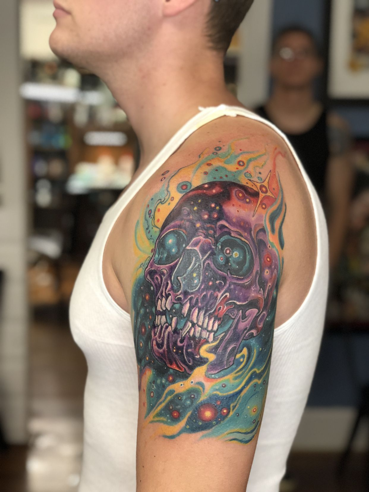 Nebula skull covering up old tribal tattoo tattoos