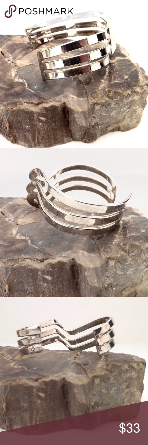 """vintage deco cuff bracelet shiny silver chevron 3 rows smooth polished steel abstract twisted chevron oval cuff bracelet very sleek modern look good vintage condition may be some minor discoloration spots up close due to age but still very shiny width varies due to shape but approx 1"""" average inside circumference 7"""" wrist opening 1 1/4"""" solid piece very little give 1.5 oz vintage Jewelry Bracelets"""
