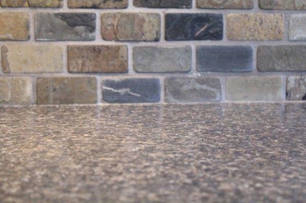 brick-joint 2x3 slate tile backsplash. Tile: Daltile – California Gold (brick-joint natural cleft) S700