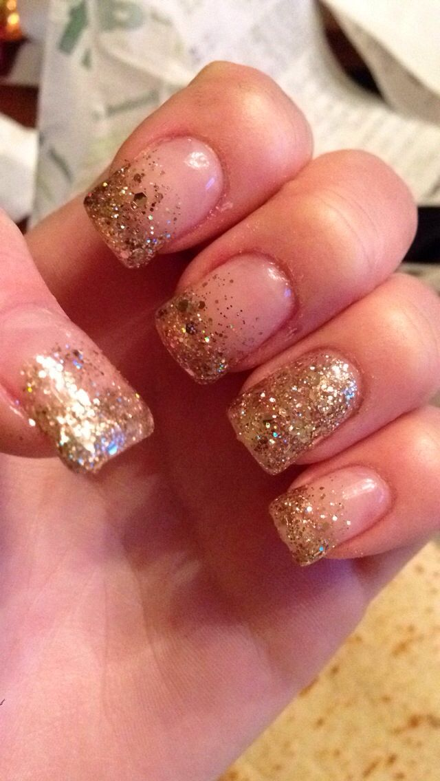 Sparkly glittery gold French tips that fade into the nail as they go ...