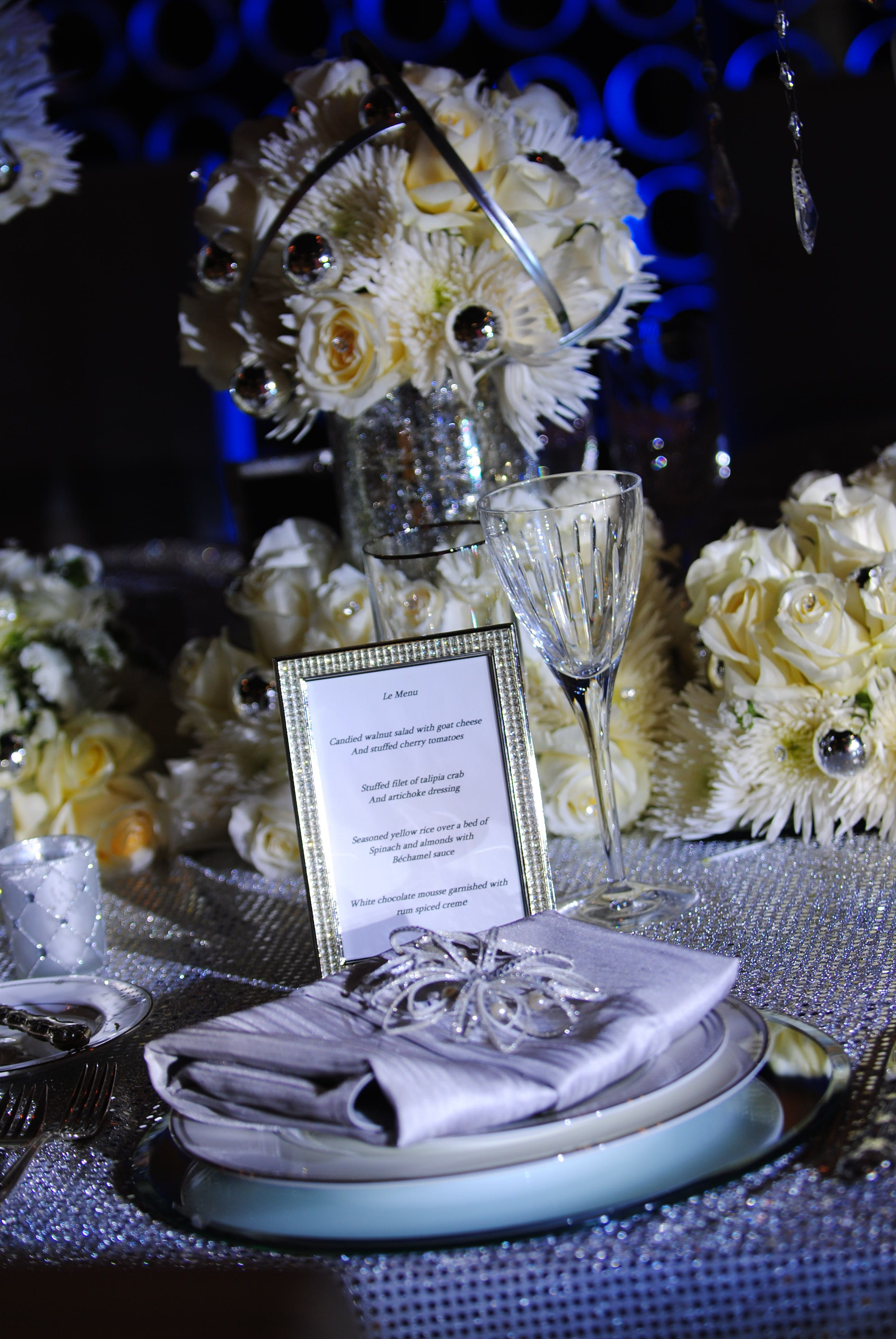 Details make a difference..menus in beautiful frames, crystal goblets, Christmas ornament for napkins that serve as favors. CP Ross Designs