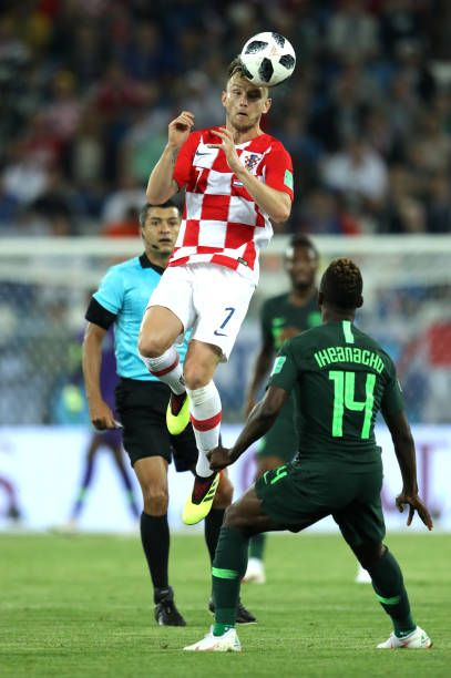 Ivan Rakitic of Croatia wins a header over Kelechi Iheanacho of Nigeria during the 2018 FIFA World Cup Russia group D match between Croatia and...