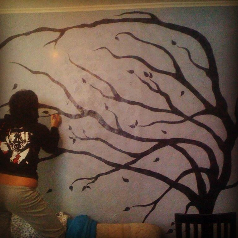 The tree I've been painting on my wall as a mural. When it's done I'm going to hang all of our family photos around it.