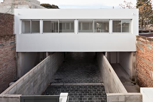 Viviendas Tolousse 4 viviendas con Patio / SMF Arquitectos