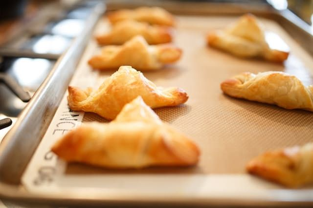 These warm, golden Nutella-stuffed puffs are an easy treat for after dinner, or a sweet indulgence for weekend brunch.
