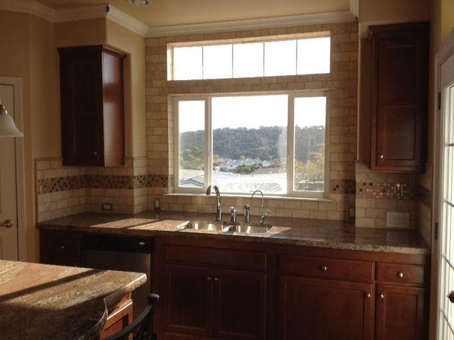 Kitchen Backsplash Around Window backsplash..like the trim around the window. this would really