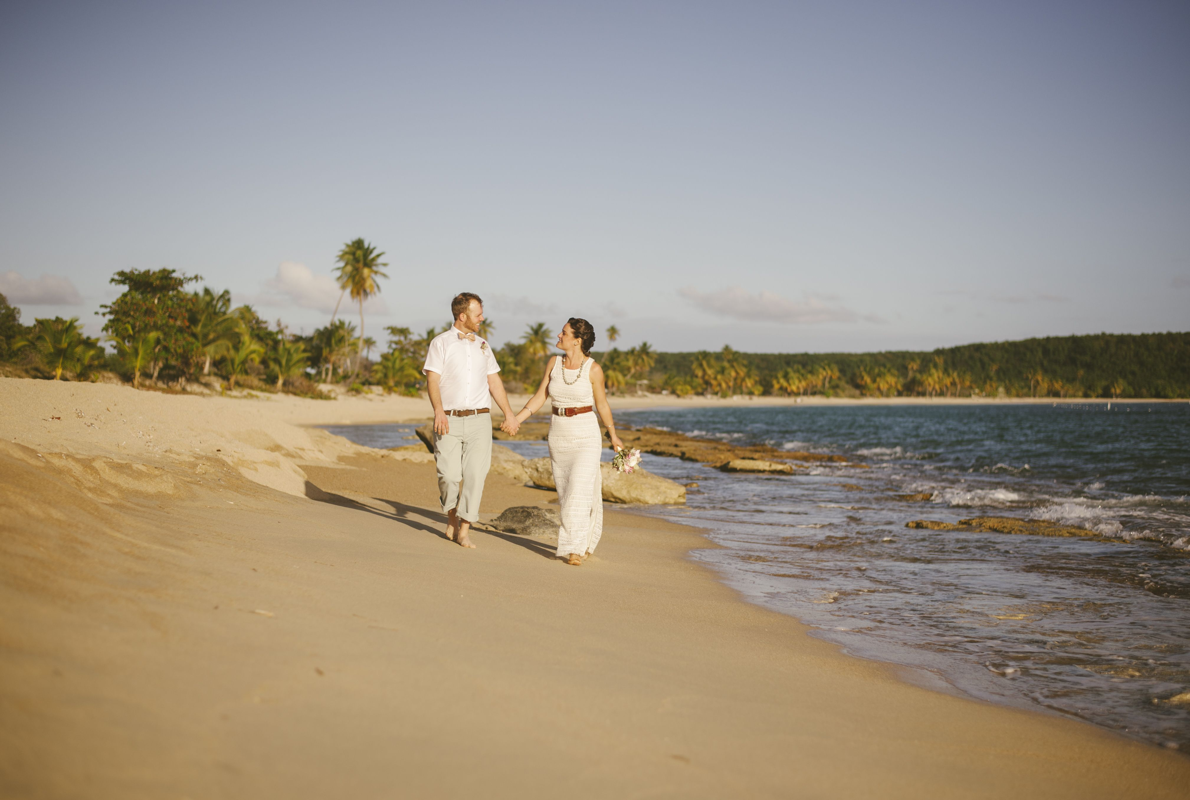 strolling down Sun Bay after intimate wedding ceremony