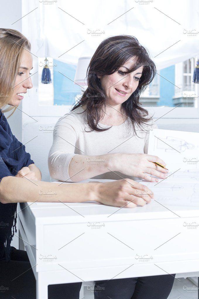 seamstress and customer choosing by Click and Photo on @creativemarket
