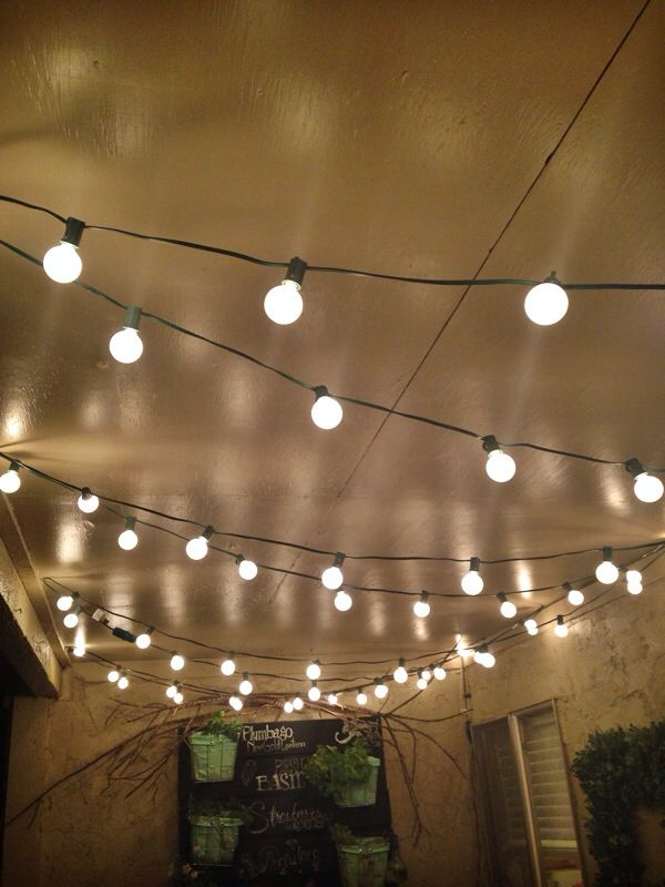 My Beautiful Italian Bistro Feel Patio Lights And Pallet Wall Garden Made  My Boring Apartment Patio