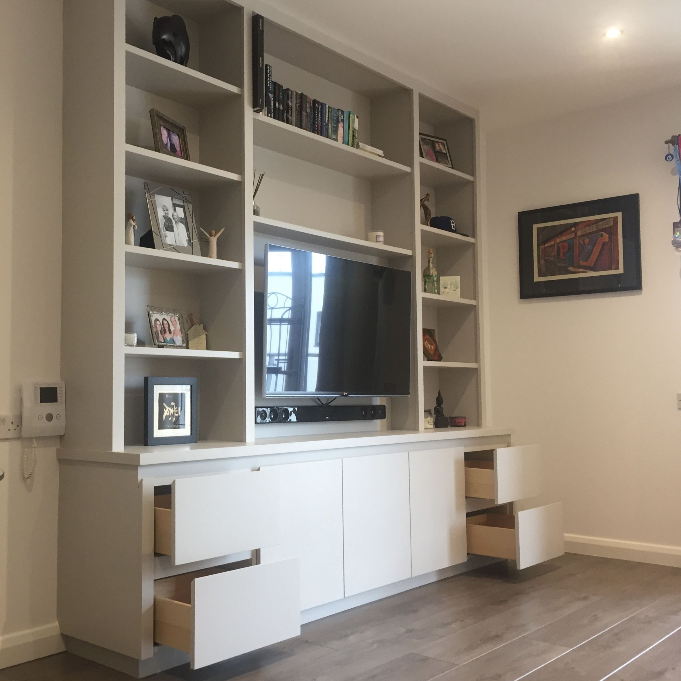 A Square Edged Contemporary Styled Tv Media Unit Shelving Cupboards And Drawer Storage Living Room Built Ins Elegant Living Room Living Room Tv Wall