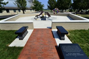 Sept. 11 Memorial is shown here shortly after the dedication at the Air Mobility Command Museum at Dover Air Force Base, Del., Sept. 11, 2013. The memorial incorporating two pieces of steel from World Trade Center tower one, a rock from the United Airlines Flight 93 crash site and a block from the damaged portion of the Pentagon, was unveiled at the ceremony. (U.S. Air Force photo/David S. Tucker)