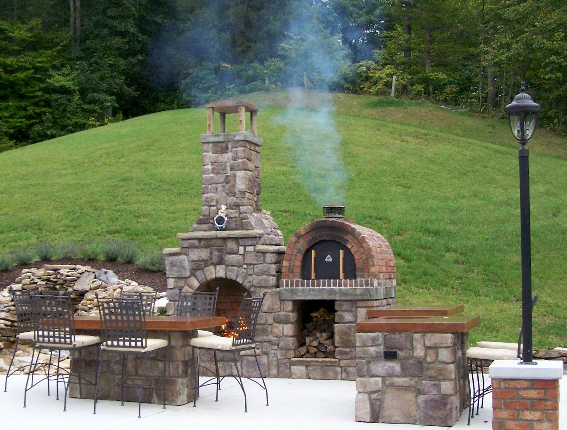 the most beautiful outdoor fireplace and wood fired brick pizza