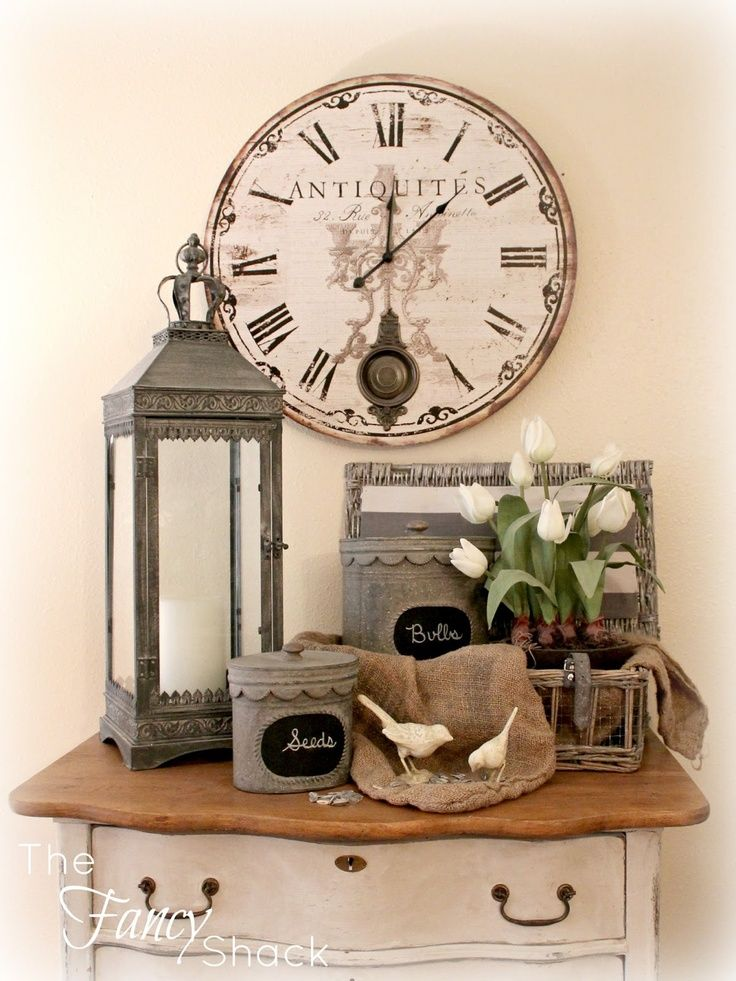 pretty spring vignette with galvanized canisters and lantern