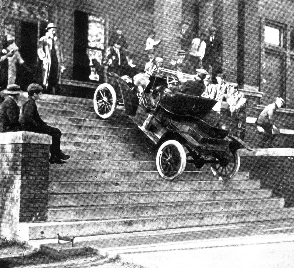 1911 Model T Runabout Driving Up Steps Of YMCA Columbus