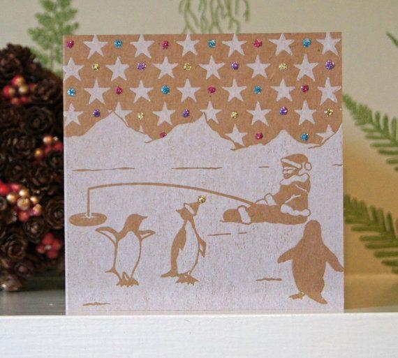 Linocut Christmas card with Santa and his by HannahAndHerPress